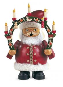 Weihnachtsmann mit Kerzenbogen