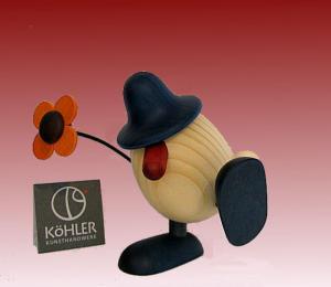 Björn Köhler Eierkopf Alfons mit Blume tanzend/sitzend