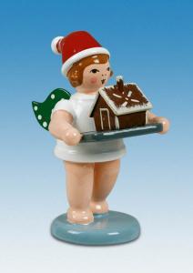 Weihnachtsengel mit Backblech und Pfefferkuchenhaus mit Mütze